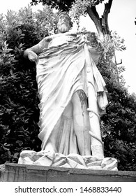 Marble statue of the Asclepius holding the rod with serpent in the Boboli Gardens (Giardino di Boboli ) in Florence, Italy (black and white)