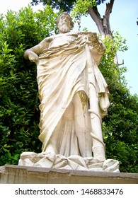 Marble statue of the Asclepius holding the rod with serpent in the Boboli Gardens (Giardino di Boboli ) in Florence, Italy