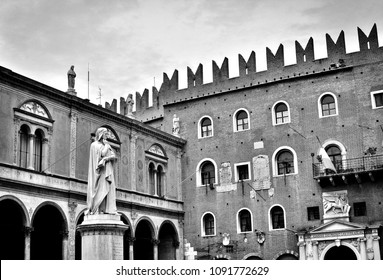 The marble statue of the famous medieval writer and poet Dante Alighieri in Verona, Italy; photos in antique black and white style.