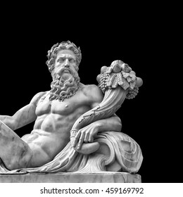 Marble statue of greek god Zeus with cornucopia in his hands isolated on black background with place for your text