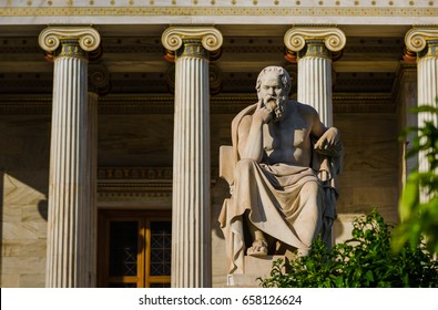 Marble statue of the Greek philosopher Socrates on the background of classical columns