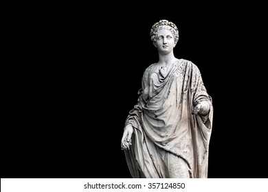 Marble statue of roman Ceres or greek Demeter isolated on black from the park of the Palace and park complex Estate of G. Galagan. Sokyryntsi village, Ukraine. Horizontal reflection of the original