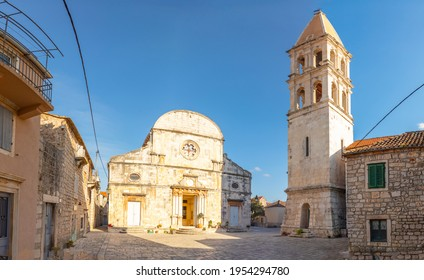 Marble stone architecture at city center with Saint Stephan Church in Stari Grad, Croatia - Shutterstock ID 1954294780