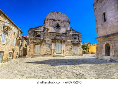 Marble stone architecture at city center in town Starigrad with 2400 years old cathedral, Croatia, Island Hvar scenery. / Selective focus.