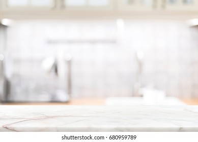 Marble stone countertop on blur kitchen interior background - can be used for display your products or food
