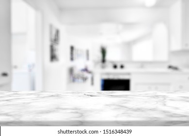 Marble stone table top (kitchen island) on blur kitchen interior background - can be used for display or montage you products