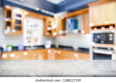 Marble stone table top on blur kitchen interior background,can be used for display or montage you products