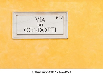 marble street plate of the famous Via dei Condotti in Rome, Italy. It is a fashionable street next to the Spanish Steps, constantly packed with tourists, shoppers and locals.