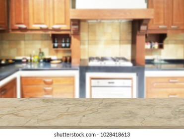 Marble table top on blur the background of the kitchen. - can be used for display your products or promotional and advertising posters