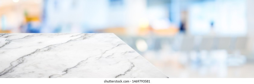marble table top product display background with blur patient in hospital.left perspective stone kitchen counter with people waiting doctor in hallway.Banner mockup presentation for  health product