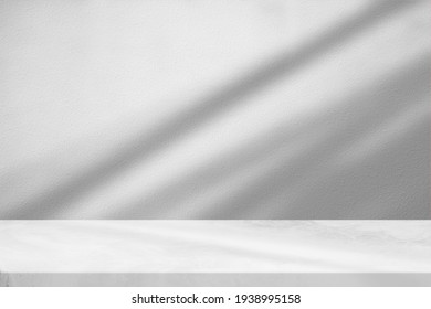 Marble Table with White Stucco Wall Texture Background with Light Beam and Shadow, Suitable for Product Presentation Backdrop, Display, and Mock up. - Shutterstock ID 1938995158