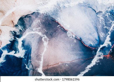 Marble texture. Acrylic ink water. Blue ocean waves sand land abstract design with white clouds effect. Natural mineral stone grain streak pattern with orange fleck veins. Luxury art background.