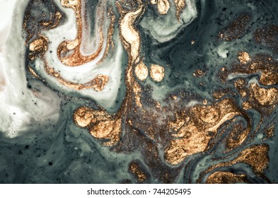 Marble texture. Eastern technique ebru. Contemporary art. Golden and turquoise mixed acrylic paints. Can be used as a trendy background for wallpapers, posters, cards, invitations, websites.