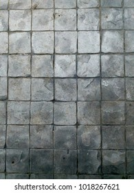 Marble tiles with a smudge of dust.