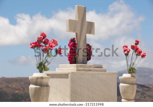 Marble tombstone in a cretan graveyard. Greek. Horizontal