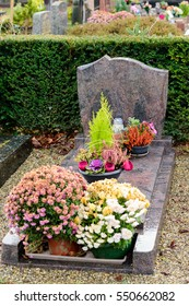 Marble tombstones in French cemetery with beautiful crafted crosses and