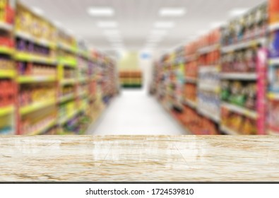 Marble top table on blur supermarket background