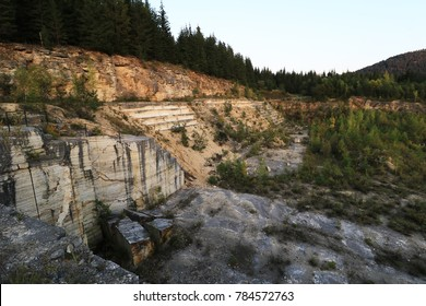 Marble travertine quarry with a mountain landscape surrounded by nature