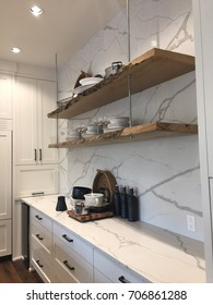 Marble white kitchen with live edge wood shelves
