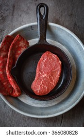 Marbled fresh raw beef steak in a cast iron pan