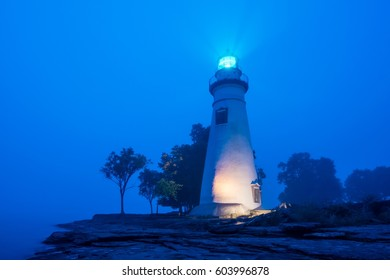 Marblehead Lighthouse in Ohio lit up on a foggy morning