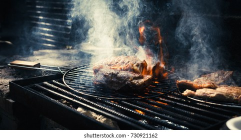 Marbling beef fat meat in fire grill charcoal Preparing Dry aged marbling beef steak aged prime marble meat over hot charcoal grill