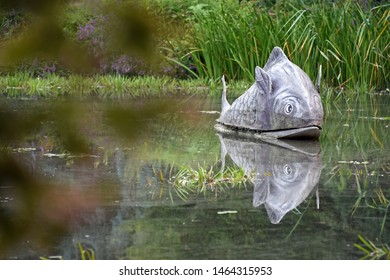 Marburg, Hessen, Germany, July 25, 2019 - Art in the Old Botanical Garden in the form of a floating fish
