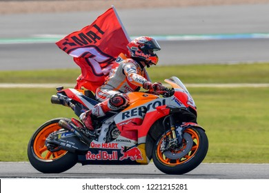 Marc Marquez no.93 of Spain and Repsol Honda Team celebrates with the flag at the victory The PTT Thailand Grand Prix - MotoGP at Chang International Circuit on October 7, 2018 in Burirum ,Thailand