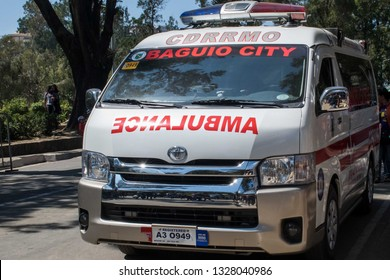March 03, 2019 - Baguio City Philippines : An ambulance stationed just outside the Melvin Jones grandstand for emergencies during the Panagbenga flower festival grand float parade. Emergency vehicle