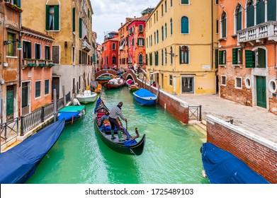 March 04, 2014:Typical canal with a gondola during an episode of acqua alta, in Venice in Veneto, Italy