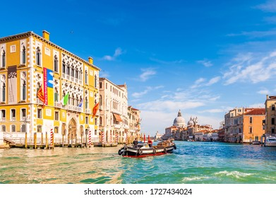 March 06, 2014: The Grand Canal and its traffic and the Basilica of Santa Maria della salute in the background in Venice in Veneto, Italy