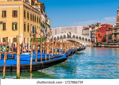 March 06, 2014: The Grand Canal, gondolas and in the background the emblematic Rialto Bridge in Venice in Veneto, Italy