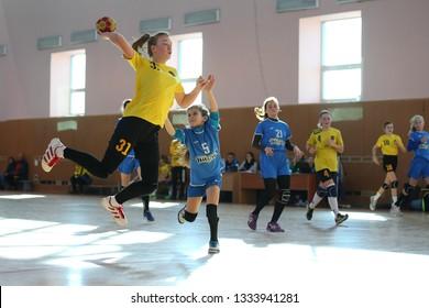 MARCH 07, 2019 - KHARKIV, UKRAINE: Kids Handball Ukrainian National Championship Tournament. Young girls playing indoor handball. Sports and physical activity. Training and sports for children.