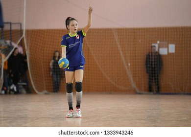 MARCH 07, 2019 - KHARKIV, UKRAINE: Kids Handball Ukrainian National Championship Tournament. Young girls playing indoor handball. Sports and physical activity. Training and sports for children.