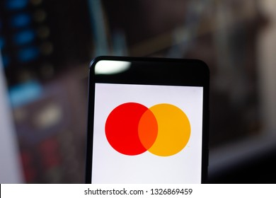 """March 1, 2019, Brazil. United States company logo of the payments sector """"Mastercard"""", on the screen of the mobile device. The Mastercard is accepted at 32 million points."""