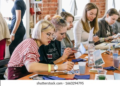 March 10, 2018. Tkachi Creative Space. Saint-Petersburg, Russia. Wake Up Day Festival. Group of people at the table at a painting master class.