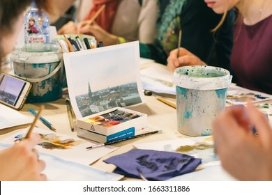 March 10, 2018. Tkachi Creative Space. Saint-Petersburg, Russia. Wake Up Day Festival. Group of people at the table at a painting master class