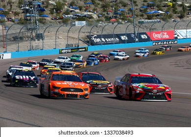 March 10, 2019 - Avondale, Arizona, USA: Kyle Busch (18) races down off the turn during the Ticket Guardian 500 at ISM Raceway in Avondale, Arizona.