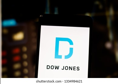 """March 10, 2019, Brazil. Logo of the United States international financial publisher """"Dow Jones & Company"""" on the screen of the mobile device."""