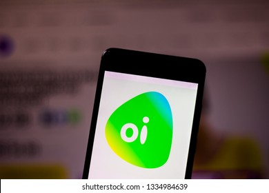 "March 10, 2019, Brazil. Operator logo ""Oi"" on the screen of the mobile device. It is a telecommunications services concessionaire in Brazil."