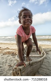 March 11, 2015 Sambo Creek, Honduras: a young garifuna girl part of the fishing community on the caribbean coast of the country stands on a dugout canoe
