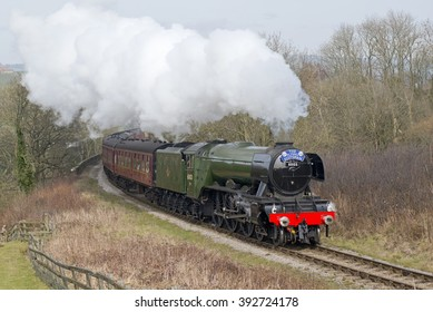 March 12, 2016 Famous preserved British steam locomotive Flying Scotsman starts its climb out of Grosmont as it clears the Esk Viaduct following its four million pound rebuild.