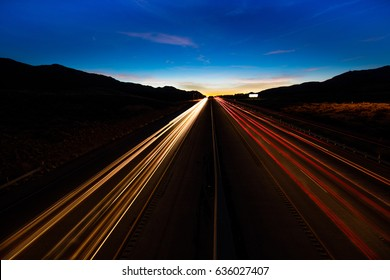 MARCH 12, 2017, LAS VEGAS, NV - streaked lights at sunset over Interstate 15, south of Las Vegas, Nevada at sunset
