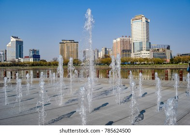 March 13th 2012, a water splash pad on a pedestrian walkway of river bank in urban area of Ningbo City in China.