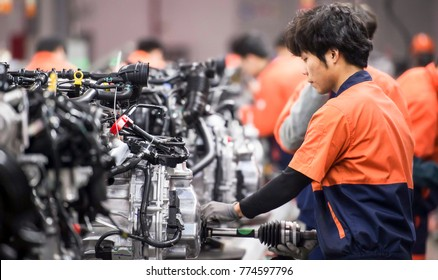March 14, 2017, Linhai, Zhejiang Province, China, Geely Automobile Manufacturing Plant, assembly plant workers are assembling the engine, representing the highest level of China's state-owned car bran