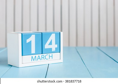 March 14th. Image of march 14 wooden color calendar with flower on white background.  Spring day.  Commonwealth and International ? Day