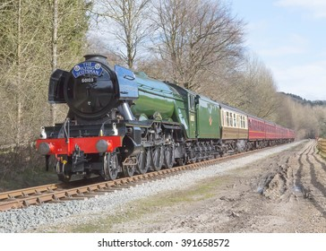 March 16, 2016 Former LNER A3 Pacific steam locomotive 60103 Flying Scotsman  in its British Railways livery approaches Pickering Station on The North Yorkshire Moors Railway, Yorkshire, England.