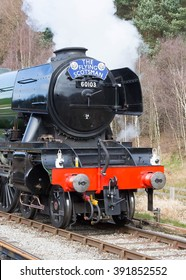 March 16, 2016 Former LNER A3 Pacific steam locomotive 60103 Flying Scotsman in its British Railways livery approaches Levisham Station on The North Yorkshire Moors Railway, Yorkshire, England.