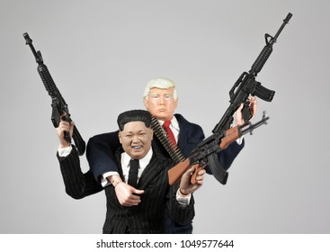 MARCH 16 2018: Caricature of North Korean Supreme Leader Kim Jong Un, US President Donald Trump brandishing firearms in a gangster style pose.
