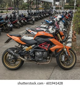 March 16,2017 orange motorbike park at the parking lot near the library at Khon Kaen university, Khon Kaen,Thailand.